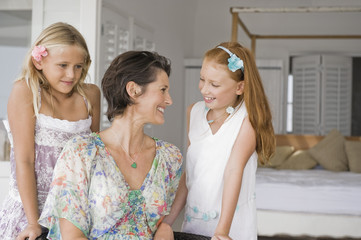 Woman smiling with her two daughters