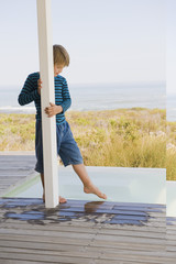 Boy standing at the poolside
