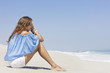 Woman sitting on the beach and thinking