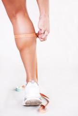 Athlete measures calves of his legs