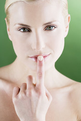 A young woman touching her lips