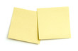 Two blank sticky notes on white