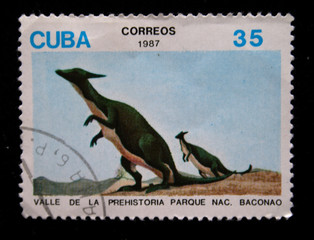 stamp printed by Cuba shows dinosaures
