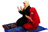 Young muslim female in traditional clothes praying