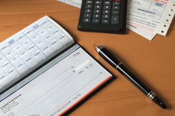 Checkbook open to pay bills