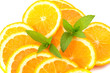 Many sliced oranges and green mint
