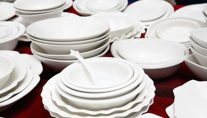 Piles of clean white plates