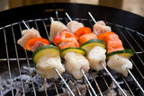 fish spear grilling on barbecue poster