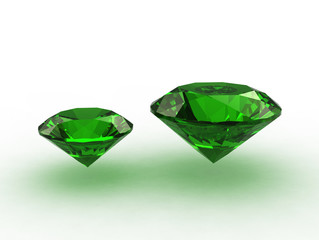 Pair of round emerald gems