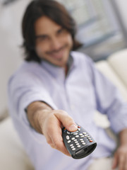 Man using television remote
