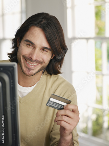 Man using credit card to shop online