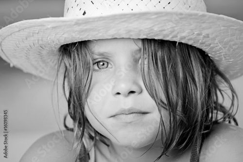 Black and White Shot of a Pretty Child in Summer Hat
