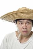 Asian peasant with blank expression and straw hat