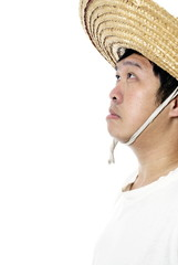 Asian peasant looking up with straw hat on white