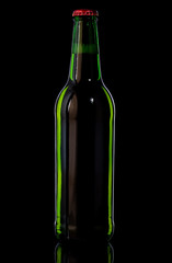 Green bottle with beer on black background
