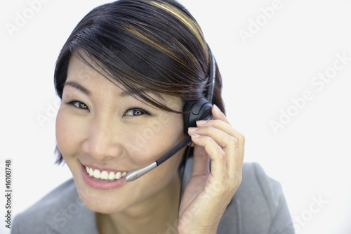 Businesswoman indoors with weird contact lenses wearing headset