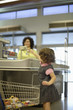 Young girl in grocery store at check-out