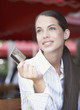 Businesswoman on outdoor patio holding credit card