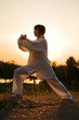 woman in white suit make's taiji chuan exercise - 8