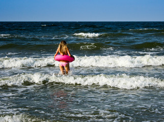 Young woman go in sea
