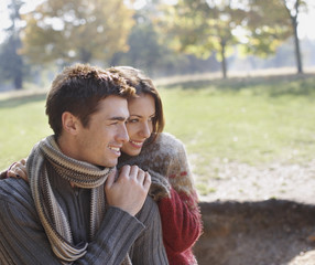 Couple outdoors being affectionate