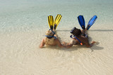 Maldives,, Couple wearing snorkeling gear at beach