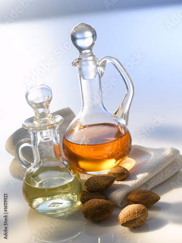 Two carafes, almonds (Prunus dulcis), towel