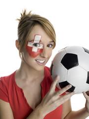 Junge Frau mit schweizer Flagge auf Gesicht gemalt, Fußballfan