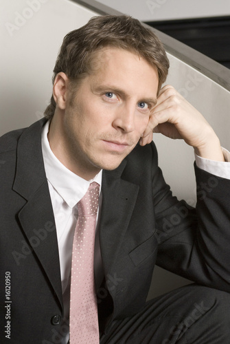 Businessman leaning head on head