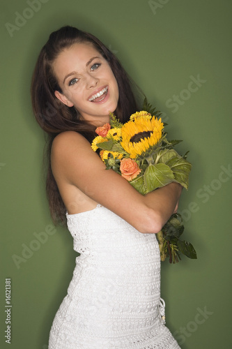 Young woman holding bouquet of flowers, portrait