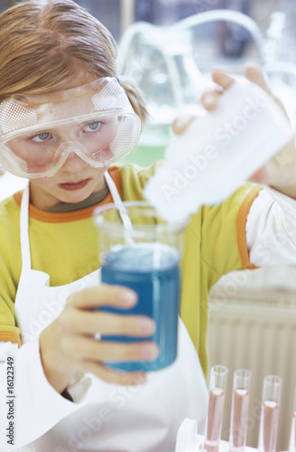 Girl (8-9) in chemical lab