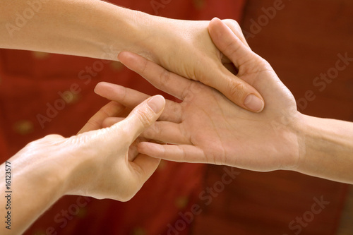 Woman receiving hand massage