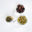Olives and capers in bowls