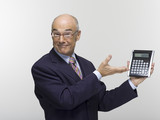 Businessman holding calculator, portrait