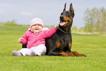 Baby and Big Black Dog