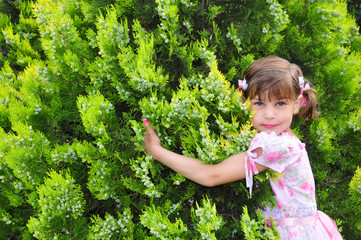 Small girl in a garden