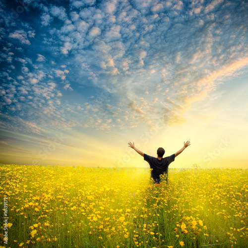 man in yellow field