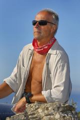 Handsome mature man posing outdoors