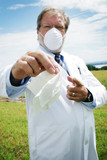 Scientist with tissue for allergies poster