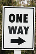 Close up of a one way sign.