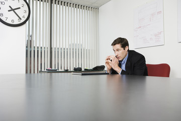View of a businessman sitting in an office.