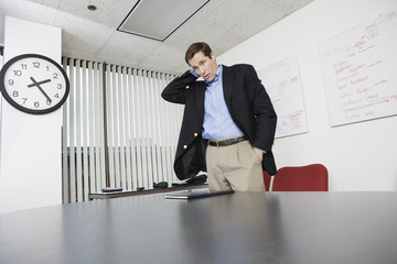 Businessman standing in an office.