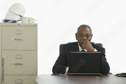 Businessman sitting at his laptop