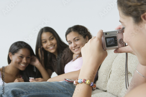 Teen girls with camera