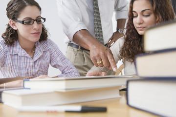 Teen students and teacher