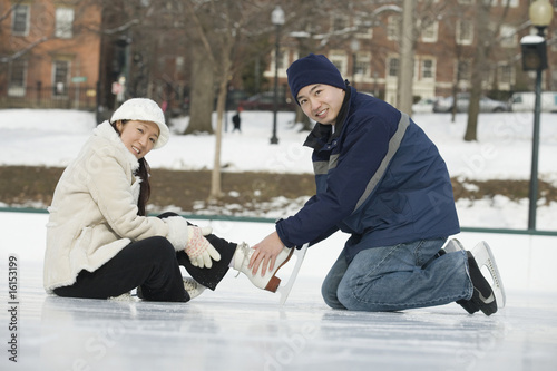 Young couple ice skating