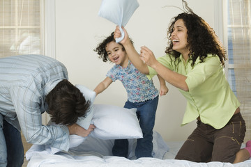 Family have a pillow fight