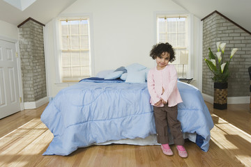 Hispanic child in her bedroom