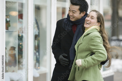Young couple shopping in winter