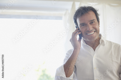 Man using cellular phone and smiling